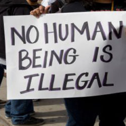 "Protest sign from an Immigration Policy rally. Sign reads ""No Human Being is Illegal"""